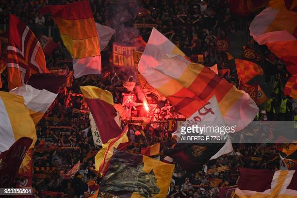 Roma's fans light a flare in the grandstand before the UEFA Champions League semifinal second leg football match AS Roma vs Liverpool FC at the...