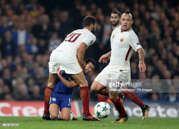 Roma's Federico Fazio and Chelsea's Pedro collide during the UEFA Champions League Group C match at Stamford Bridge London