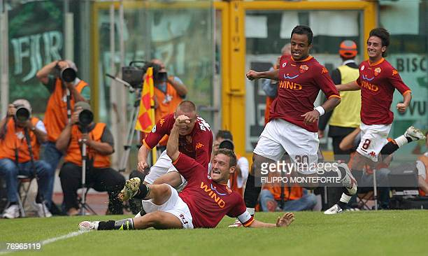 AS Roma's forward and captain Francesco Totti jubilates with teamates after scoring against Juventus during their Serie A football match in Rome's...