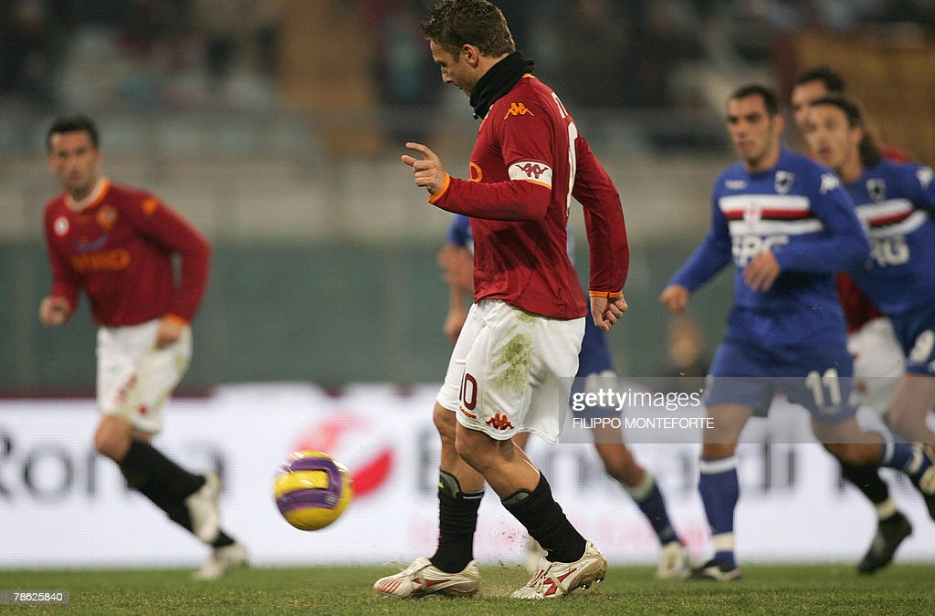 AS Roma's forward and captain Francesco Totti (C) spoon kicks a penalty and scores against Sampdoria during their Serie A football match in Rome's Olympic Stadium 22 December 2007.
