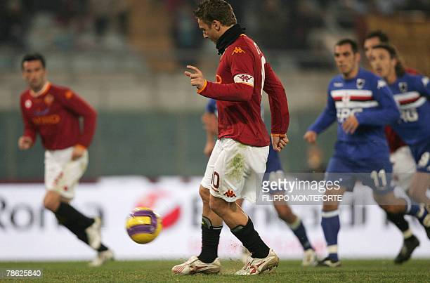 AS Roma's forward and captain Francesco Totti spoon kicks a penalty and scores against Sampdoria during their Serie A football match in Rome's...