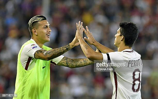 Roma's forward Diego Perrotti celebrates after scoring a goal during the Serie A football match between Cagliari and Roma at the Sant'Elia stadium in...
