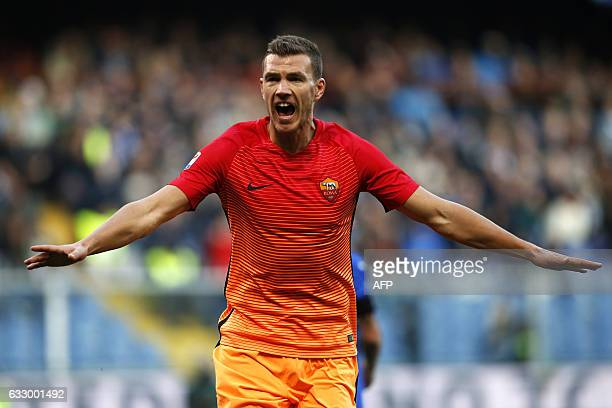 AS Roma's forward Edin Dzeko from BosniaHerzegovina celebrates after scoring during the Italian Serie A football match Sampdoria Vs As Roma on...