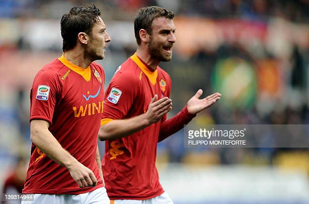 AS Roma's forward Francesco Totti and midfileder Daniele De Rossi react during their Italian Serie A football match against Parma at the Olympic...