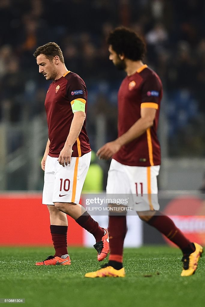 Roma's forward Francesco Totti and Roma's midfielder from Egypt Mohamed Salah (R) react at the end the UEFA Champions League football match AS Roma vs Real Madrid on Frebruary 17, 2016 at the Olympic stadium in Rome. Real Madrid won 0- 2.