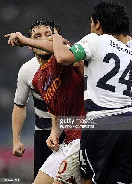 Roma's forward Francesco Totti argues with Lazio's Brazilian midfielder Francelino Matuzalem during their Italian Serie A football match in Rome's...