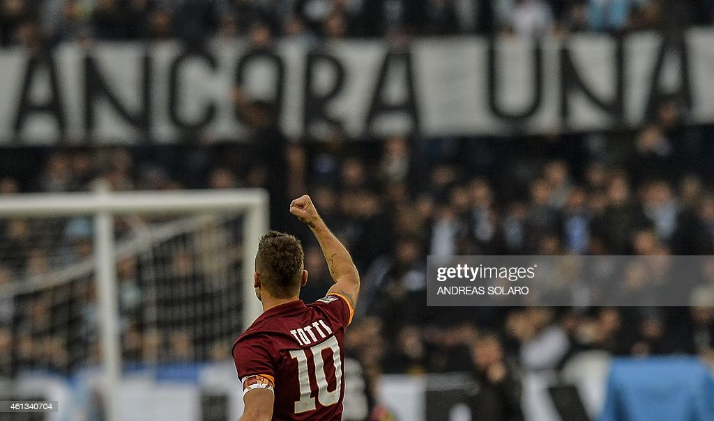 Roma's forward Francesco Totti celebrates after scoring during the Italian Serie A football match AS Roma vs Lazio on Janury 11, 2015 at Rome's Olympic stadium. The match ended in a drow 2-2.