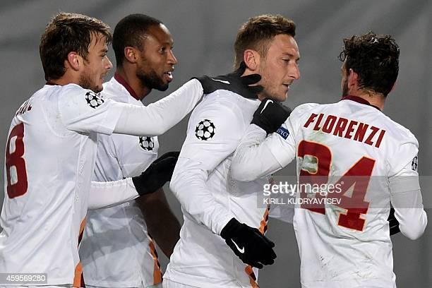 Roma's forward Francesco Totti celebrates with his teammates scoring a goal at Khimki arena outside Moscow on November 25 during their UEFA Champions...