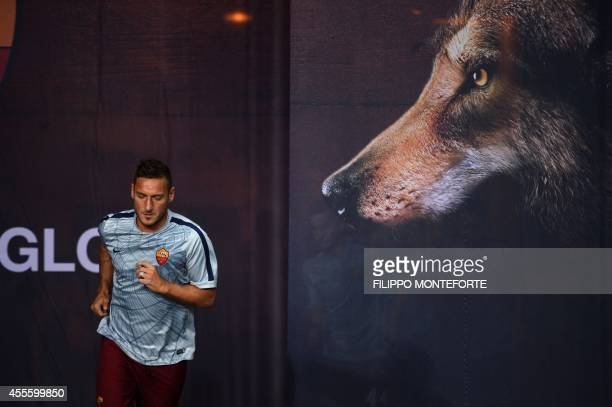 AS Roma's forward Francesco Totti enters the field prior the UEFA Champions League football match AS Roma vs CSKA Moskva on September 17 2014 at the...