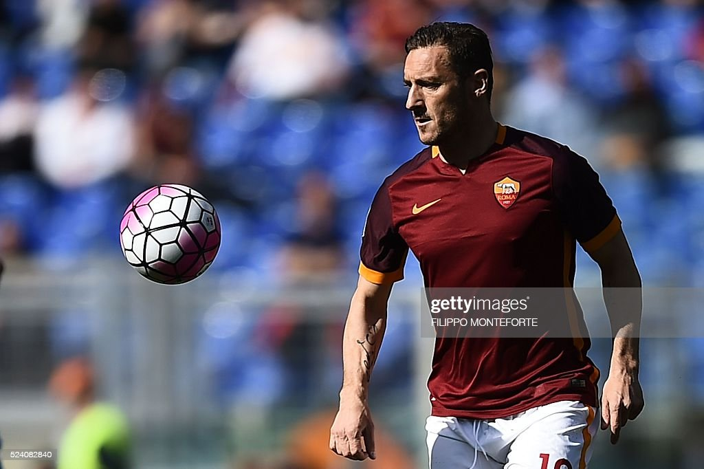 Roma's forward Francesco Totti eyes the ball during the Italian Serie A football match AS Roma vs Napoli on April 25, 2016 at the Olympic Stadium in Rome.