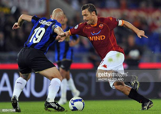 AS Roma's forward Francesco Totti fights for the ball against Inter Milan's Argentinian midfielder Esteban Matias Cambiasso during their Italian...