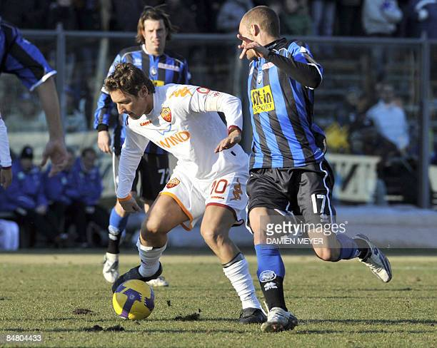 Roma's forward Francesco Totti fights for the ball with Atalanta 's midfielder Tiberio Guarente during the Italian Serie A football match Atalanta...