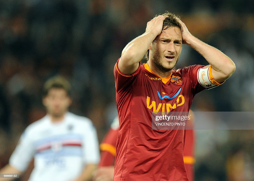 AS Roma's forward Francesco Totti (R) reacts after loosing a score against Sampdoria during their Serie A football match at Olympic stadium in Rome on April 25, 2010.
