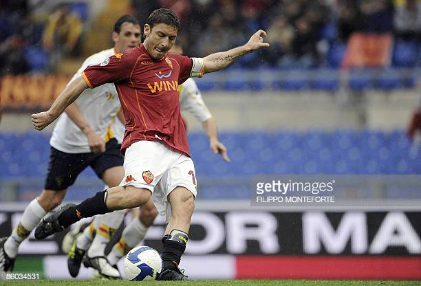 Roma's forward Francesco Totti shoots a penalty kick to score against Lecce during their Serie A football match at Rome's Olympic Stadium on April...