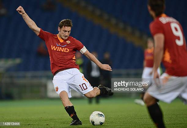 AS Roma's forward Francesco Totti shoots to score against Catania on May 5 2012 during an Italian Serie A football match at Rome's Olympic stadium...
