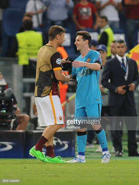 Roma's forward Francesco Totti togheter Barcelona's forward Lionel Messi during the champions league football match AS Roma vs Barcelona FC at the...