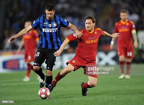 AS Roma's forward Francesco Totti vies Inter Milan's Brazilian midfielder Thiago Motta during their Coppa Italia final on May 5 2010 at Olimpico...