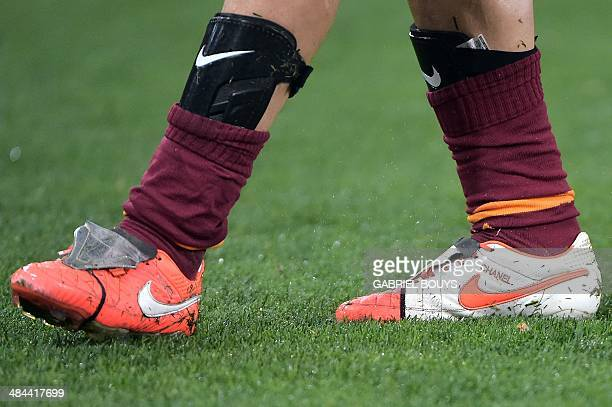AS Roma's forward Francesco Totti wears shoes with his daughter's name Chanel during the Italian Serie A football match between AS Roma and Atalanta...