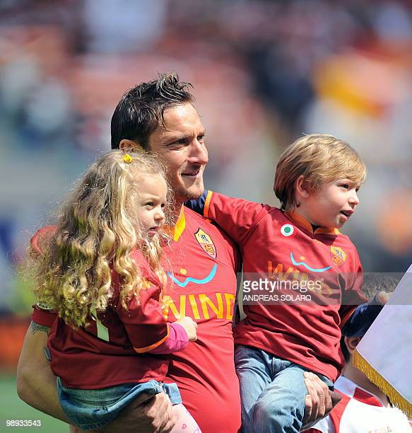 AS Roma's forward Francesco Totti with his children Chanel and Christian before his team's Italian Serie A football match on May 9 2010 at Rome's...