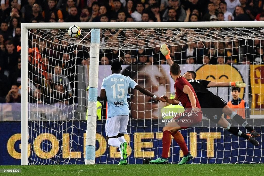 Roma's forward from Bosnia and Herzegovina Edin Dzeko (R) hits the crossbar during the Italian Serie A football match Lazio vs Roma on April 15, 2018 at Olympic stadium in Rome. /