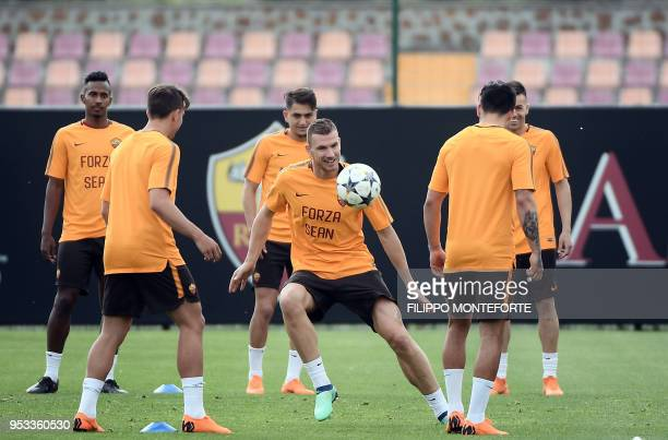 Roma's forward from Bosnia and Herzegovina Edin Dzeko plays the ball during a training session at Roma training ground in Trigoria on May 1 a day...
