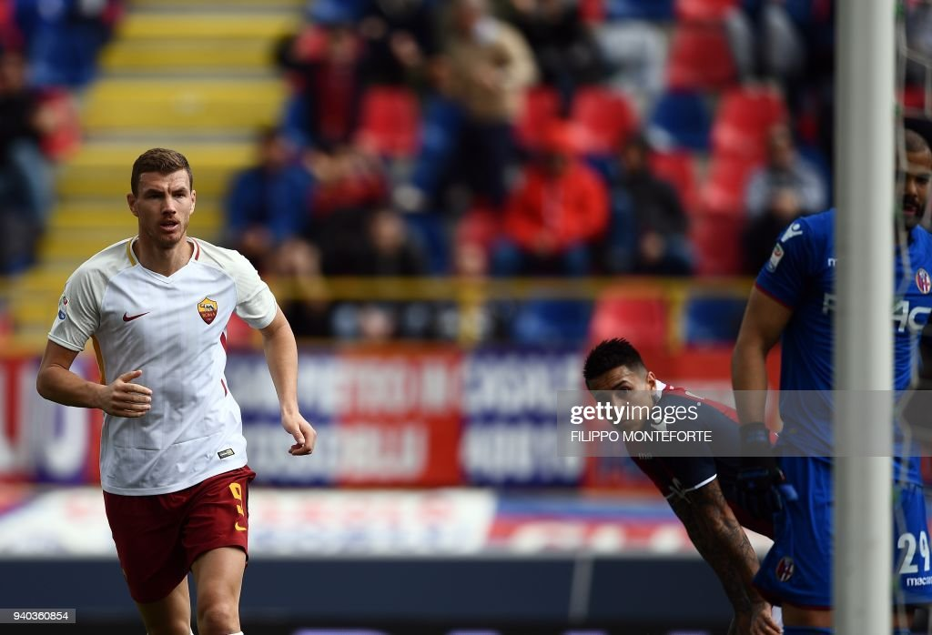 Roma's forward from Bosnia ed Erzegovina Edin Dzeko celebrates after scoring during the Italian Serie A football match Bologna vs AS Roma at the Renato D'all'Ara Stadium in Bologna, on March 31, 2018. /