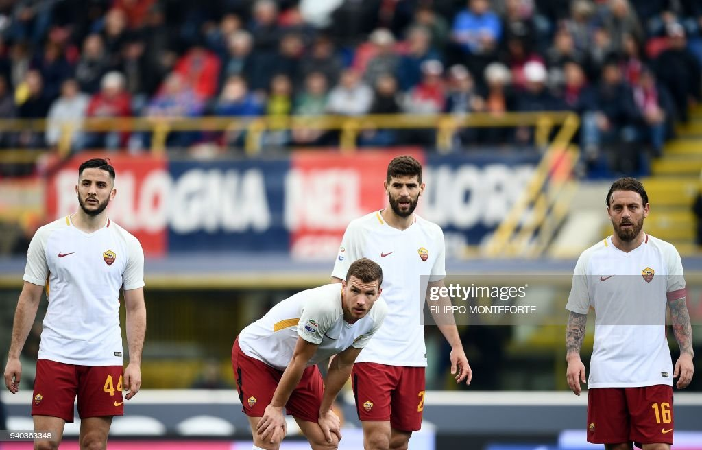 Roma's forward from Bosnia ed Erzegovina Edin Dzeko (C) reacts next to teammates Roma's Greek defender Kostas Manolas, Roma's Argentinian defender Federico Fazio and Roma's Italian midfielder Daniele De Rossi (R) during the Italian Serie A football match Bologna vs AS Roma at the Renato D'all'Ara Stadium in Bologna, on March 31, 2018. /