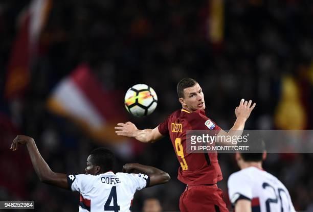Roma's forward from Bosnia Edin Dzeko and Genoa's midfielder from Ghana Isaac Cofie go for a header during the italian Serie A football match Roma vs...
