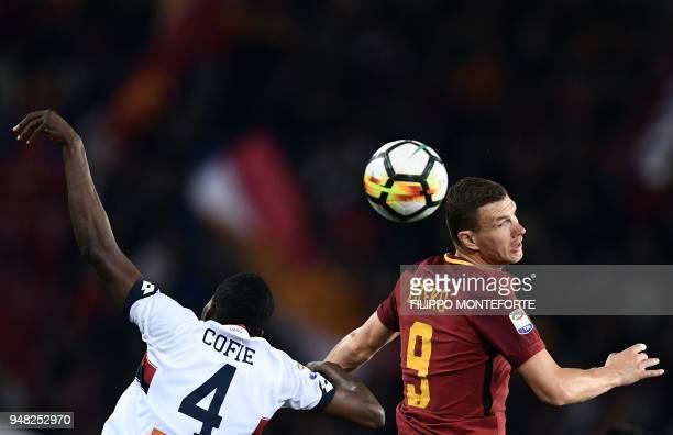 TOPSHOT Roma's forward from Bosnia Edin Dzeko and Genoa's midfielder from Ghana Isaac Cofie go for a header during the italian Serie A football match...