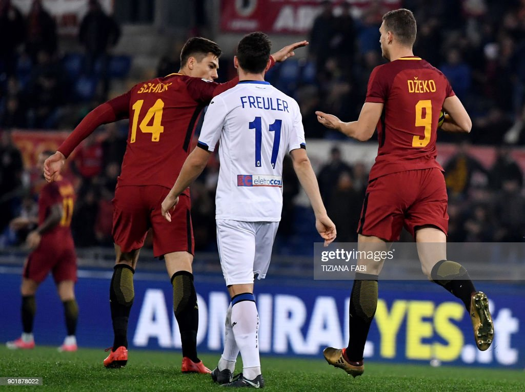 Roma's forward from Bosnia Edin Dzeko (R) celebrates with teammates after scoring a goal during the Serie A football match between Roma and Atalanta at The Olympic Stadium in Rome on January 6, 2018. /
