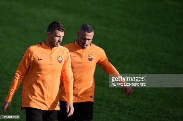 Roma's forward from Bosnia Erzegovina Edin Dzeko and midfielder from Belgium Radja Nainggolan take part in a training session a day before Champion's...