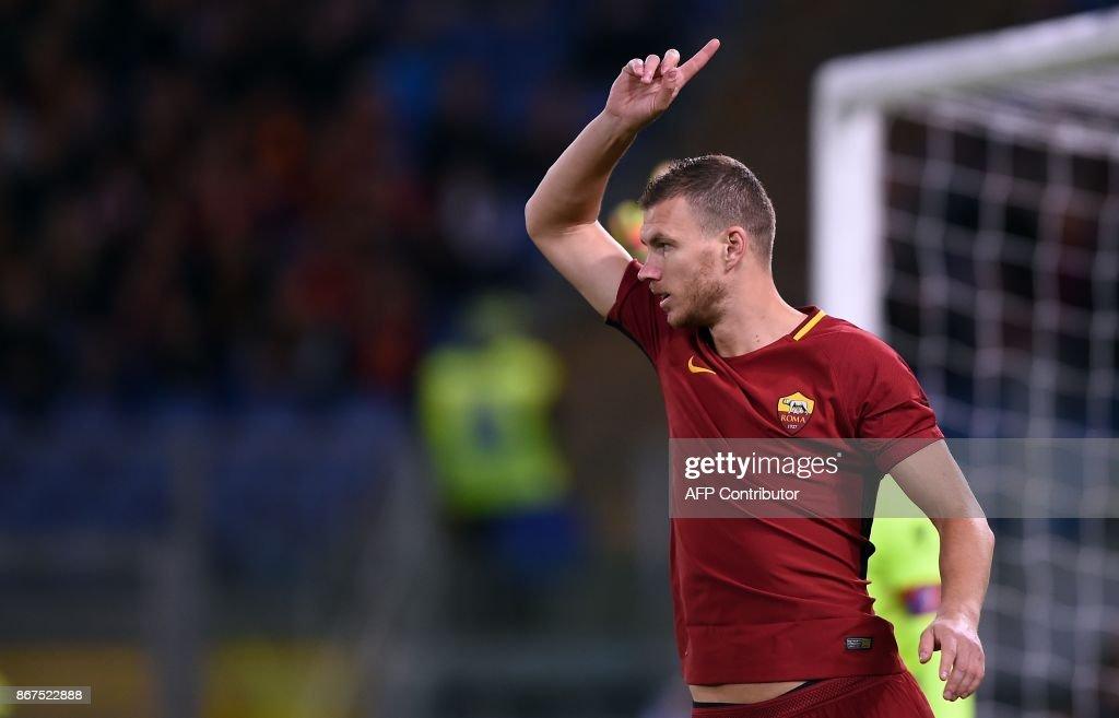 Roma's forward from Bosnia Erzegovina Edin Dzeko reacts during the Italian Serie A football match Roma vs Bologna on October 28, 2017 at the Olympic Stadium in Rome. /