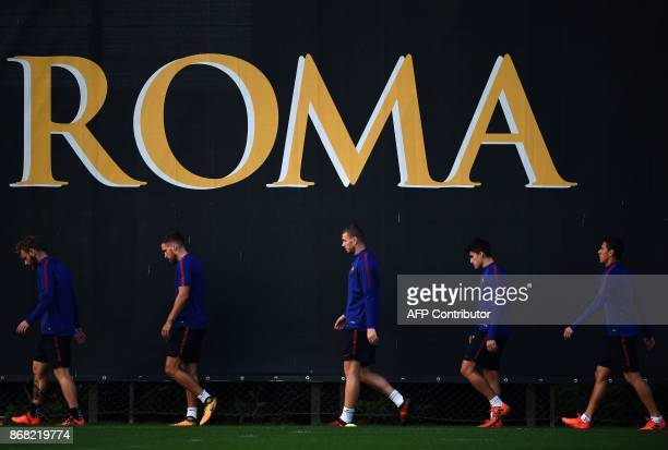 Roma's forward from BosniaHerzegovina Edin Dzeko takes part in a training session with teammates on the eve of the UEFA Champions League football...