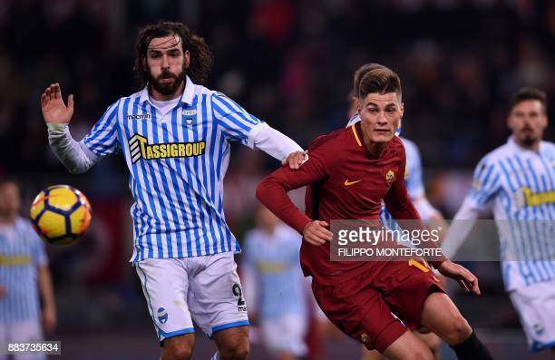 AS Roma's forward from Czech Republic Patrik Schick vies with Spal's midfielder Luca Mora during the Italian Serie A football match AS Roma vs Spal...