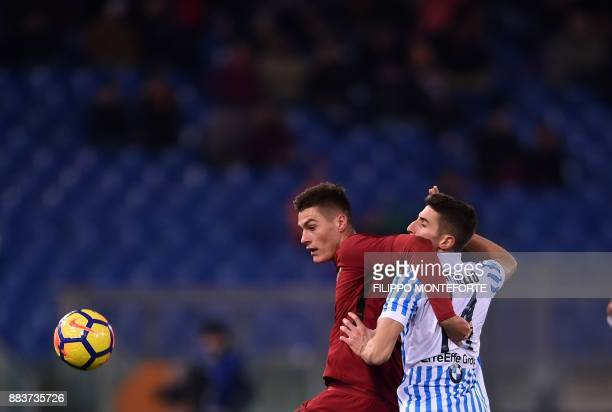 AS Roma's forward from Czech Republic Patrik Schick vies with Spal's defender Federico Mattiello during the Italian Serie A football match AS Roma vs...
