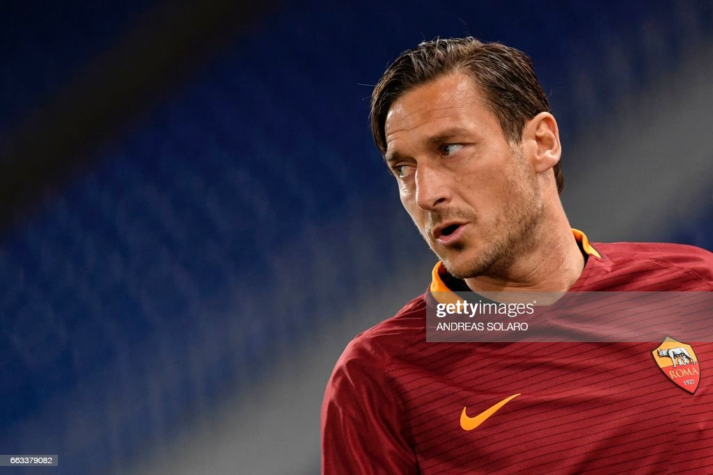 AS Roma's forward from Italy Francesco Totti looks on during the Italian Serie A football match AS Roma versus Empoli on April 1, 2017 at Olympic stadium in Rome. /