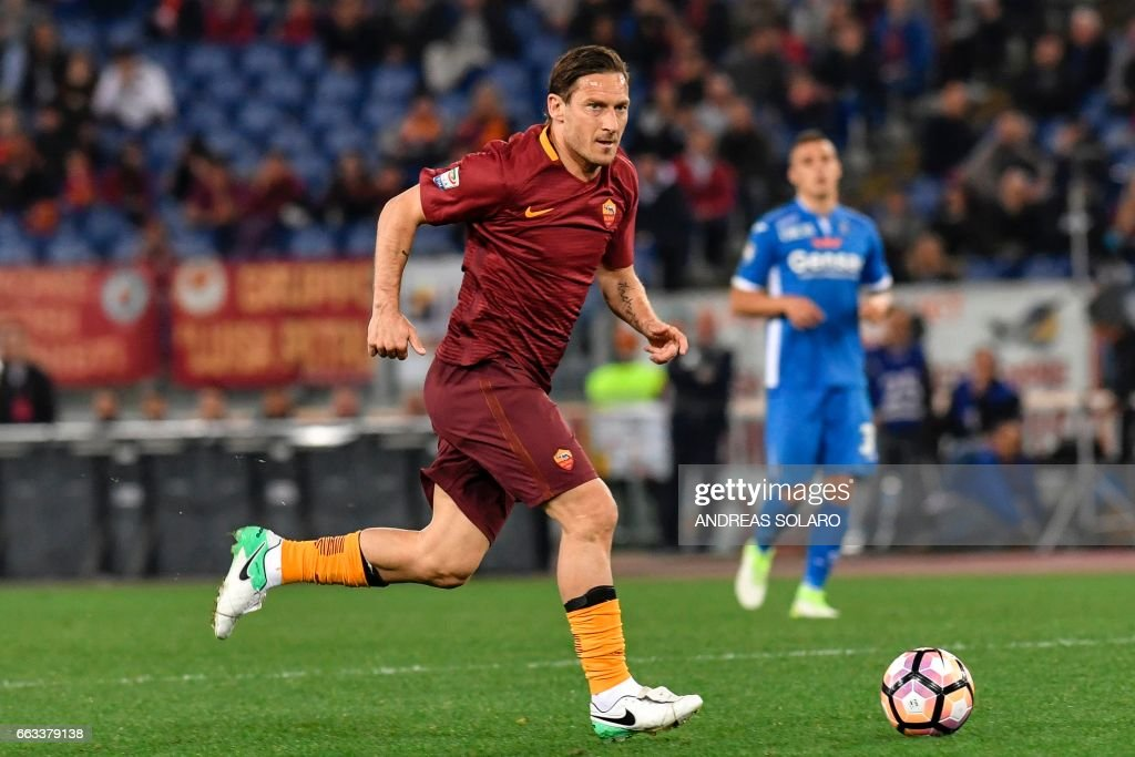 AS Roma's forward from Italy Francesco Totti runs with the ball during the Italian Serie A football match AS Roma versus Empoli on April 1, 2017 at Olympic stadium in Rome. /