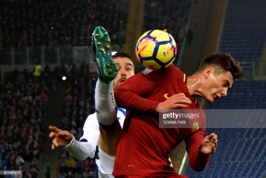 TOPSHOT - Roma's forward from Patrick Schick fights for the ball Atalanta'sItalian midfielder Leonardo Spinazzola during the Serie A football match between Roma and Atalanta at Olimpic stadium in Rome on January 6, 2018. /