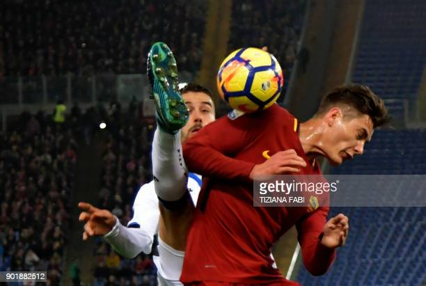 TOPSHOT Roma's forward from Patrick Schick fights for the ball Atalanta'sItalian midfielder Leonardo Spinazzola during the Serie A football match...