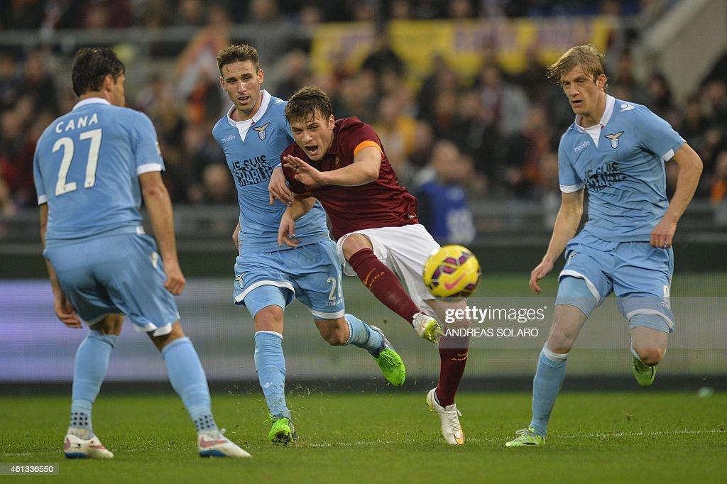 Roma's forward from Serbia Adem Ljajic (C) kicks the ball during the Italian Serie A football match AS Roma vs Lazio on January 11, 2015 in Rome.