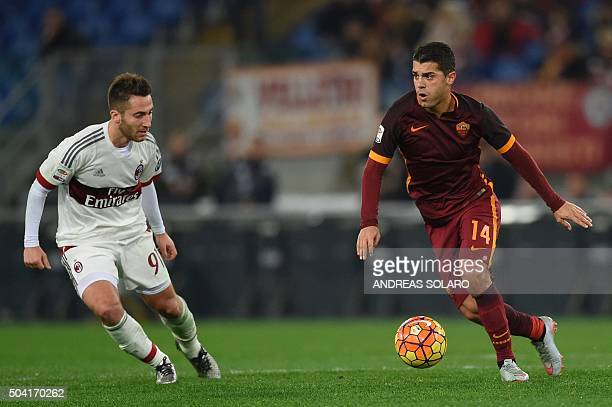 Roma's forward from Spain Iago Falque controls the ball against AC Milan's midfielder from Italy Andrea Bertolacci during the Italian Serie A...