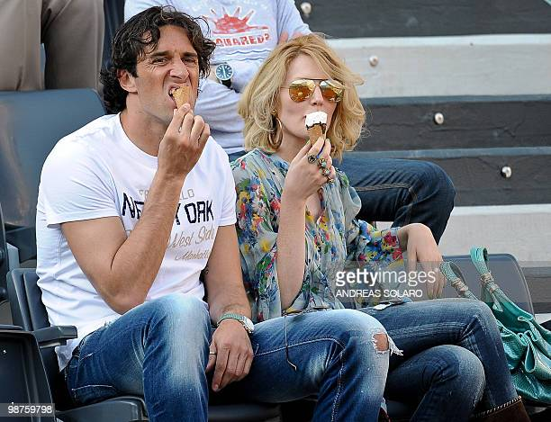 Roma's forward Luca Toni eats and ice cream as he watches the ATP Tennis Open match between Britain's Andy Murray and Spanish David Ferrer in Rome on...