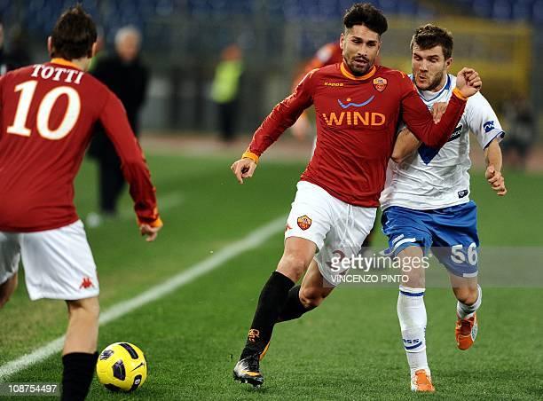 Roma's forward Marco Borriello runs past Brescia's Finnish midfielder Perparim Hetemaj in front of AS Roma's forward Francesco Totti during their...