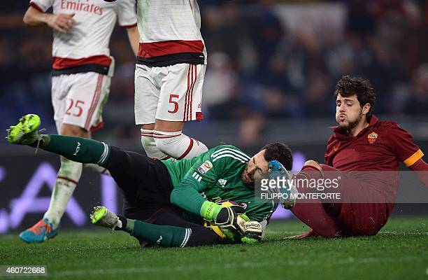 Roma's forward Mattia Destro vies with AC Milan's goalkeeper Michael Agazzi during Serie A football match in Rome's Olympic Stadium on December 20...