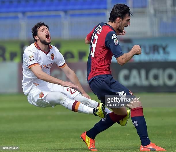 AS Roma's forward Mattia Destro vies with Cagliari's defender Davide Astori during the Italian Serie A football match between Cagliari vs AS Roma on...
