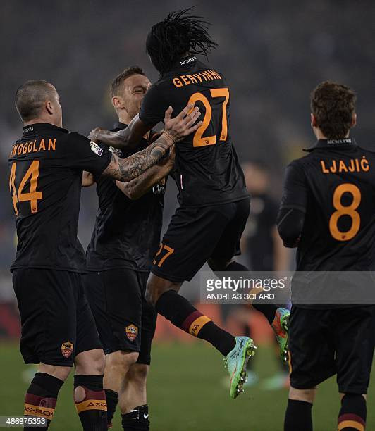 AS Roma's forward of Ivory Coast Gervinho celebrates with his team mate after scoring against Napoli during their semi'final Coppa Italia football...