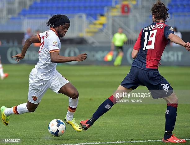AS Roma's forward of Ivory Coast Gervinho vies with Cagliari's Greek defender Marios Oikonomou during the Italian Serie A football match between...
