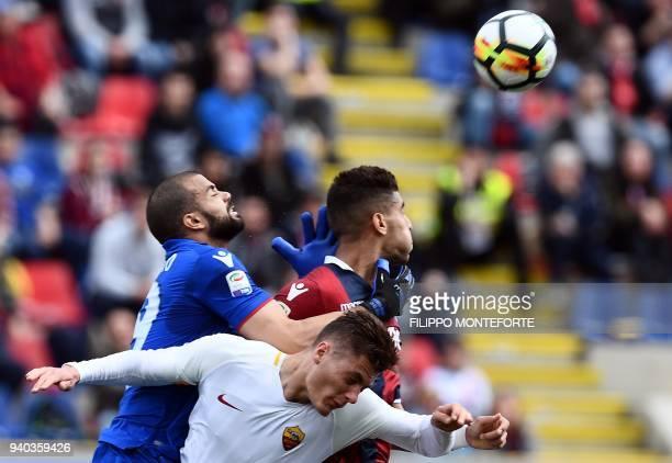 Roma's forward Patrik Schick from Czech Republic vies with Bologna's goalkeeper Antonio Santurro and defener Adam Masina during the Italian Serie A...