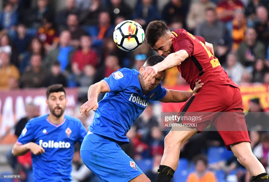 Roma's forward Stephan El Shaarawy (R) fights for the ball with Fiorentina's defender from France Vincent Laurini during the Italian Serie A football match AS Roma vs Fiorentina on April 7, 2018 at the Olympic stadium in Rome. /