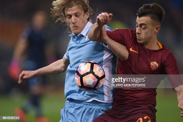 Roma's forward Stephan El Shaarawy vies with Lazio's defender from Serbia Dusan Basta during the Italian Tim Cup second leg semifinal football match...